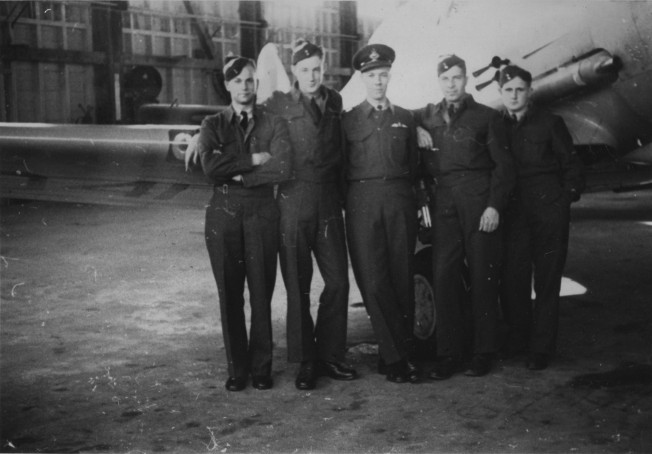 Student pilots at No. 2 S.F.T.S. Uplands with their instructor Walter Neil Dove
