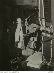 RAAF trainee wireless/air gunner receives messages as part of an exercise during his course at No. 1 Wireless Air Gunnery School RAAF Ballarat circa 1944