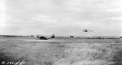 PL-11801 15 August 1942 #9 Bombing & Gunnery Mont Joli Qc., ECA Detachement, A big Canso amphibian aircraft forsakes its usual environment and proves its versatility by*settling down on a landing field at a R.C.A.F. station in eastern Canada. These Canadian-built Cansos, flown by R.C.A.F. coastal patrol crews, are constantly patrolling Canada's coast lines. Hudson A/C taking Off